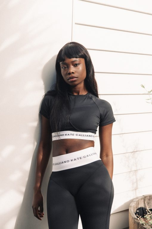 black high waisted leggings and cropped sports tee