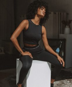 black leggings and cropped sports top