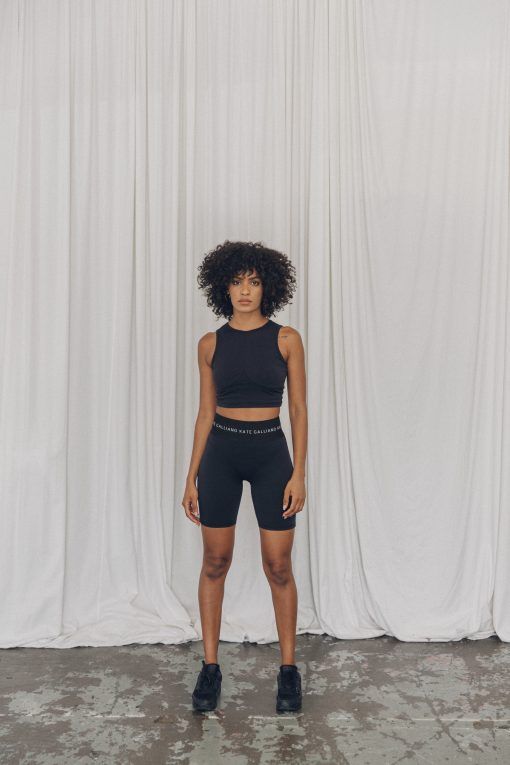 black bike shorts and cropped sports top